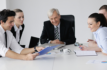 Business people at conference table image